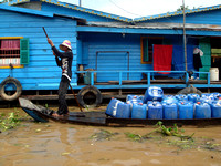 Selling Water on Water - Floating village at Tonle Sap