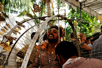 A Devotee Having His Kavadi Assembled